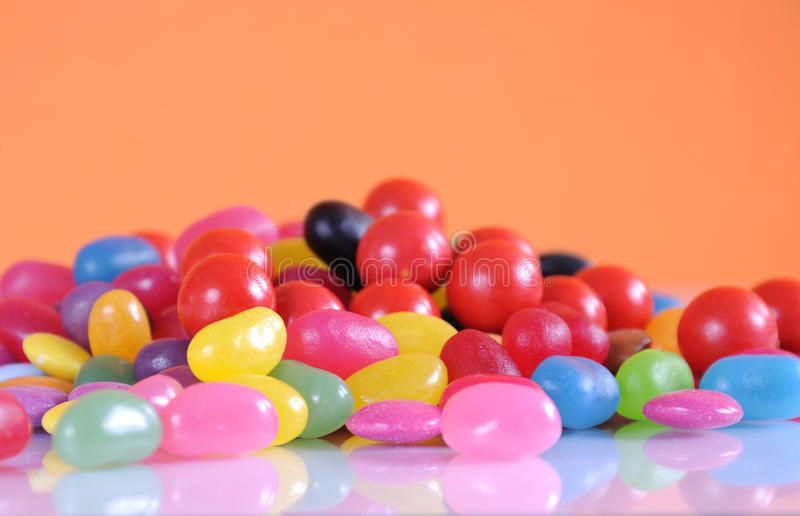 Halloween candy close up on white reflective background stock images