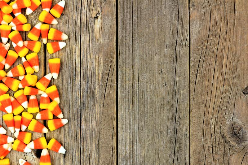 Halloween candy corn side border over old wood stock photography