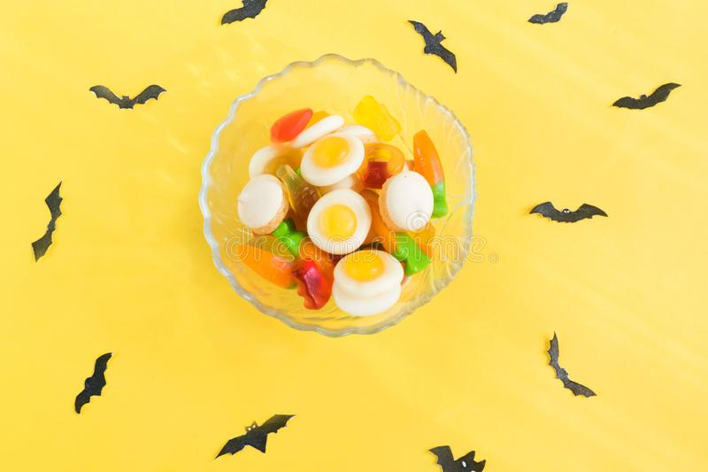 Halloween candy.Halloween holidays on yellow background, colorful decoration toys, baby sweets, donuts, marmalade. trick or treat stock photo