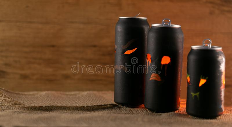 Halloween cans. 3three family cans on textil and old wooden background. Concept Halloween background royalty free stock photo