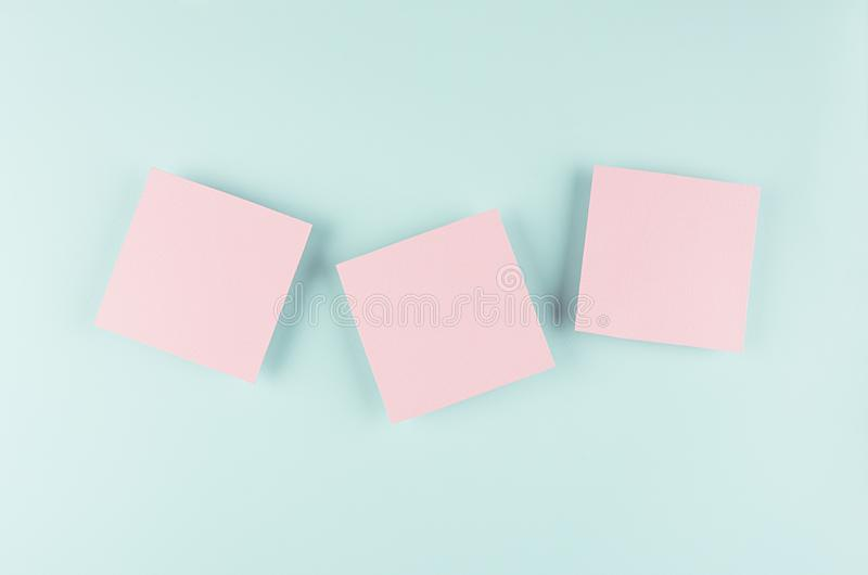 Halloween cartoon mock up for advertising, design, cover - pink paper squares on pastel mint background. royalty free stock photo