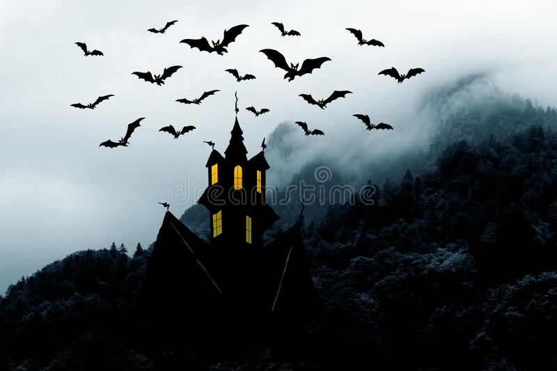 Halloween. Castle in mountains and bats royalty free stock photo