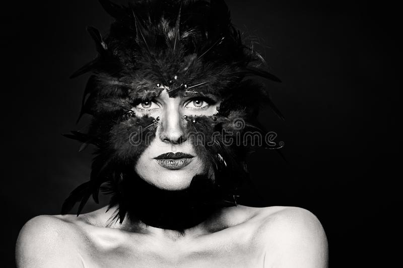 Halloween character, black and white portrait. Bird woman makeup on dark royalty free stock photo