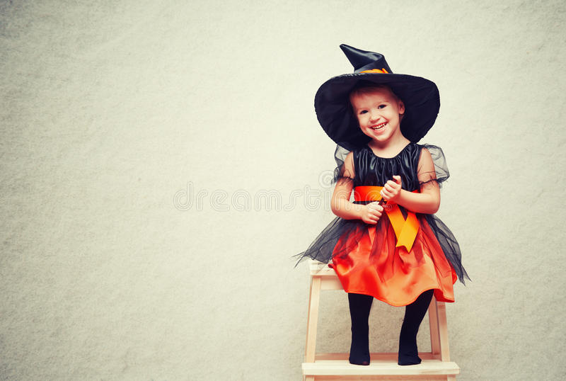 Halloween. cheerful little witch with a magic. royalty free stock photography