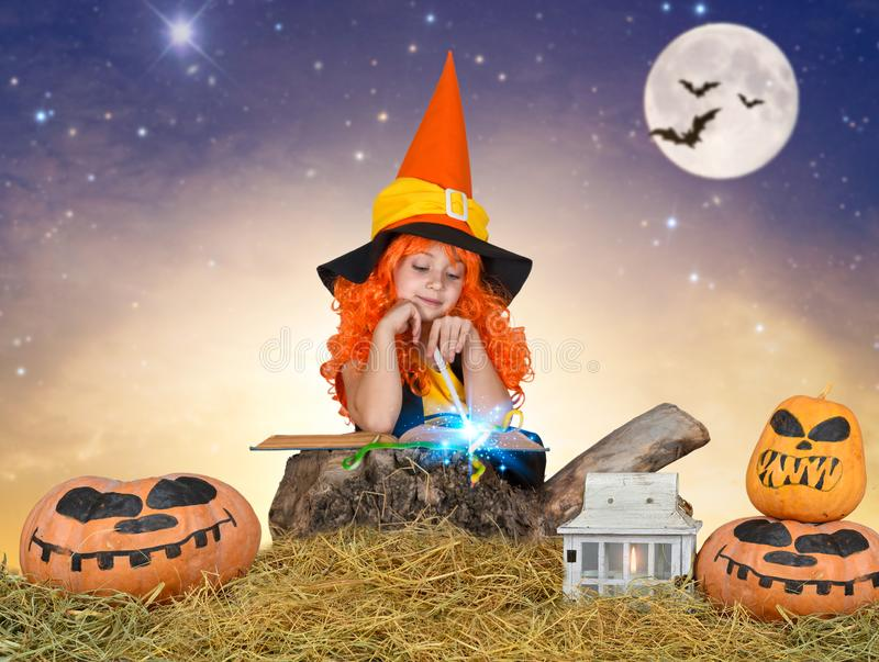 Halloween.Children in costumes for Halloween walk in the woods at night and conjure. royalty free stock photo