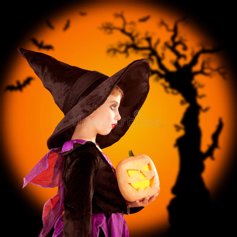 Halloween children girl holding pumpkin stock photography