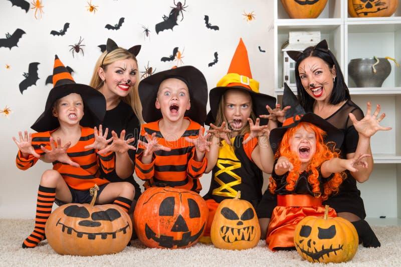 Children with moms celebrating Halloween. royalty free stock photo