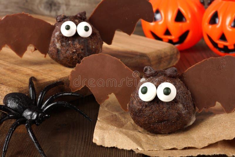 Halloween chocolate donut hole bats with decor royalty free stock image