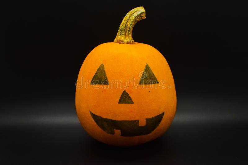 Handmade Halloween colored pumpkin isolated on black background. Studio shot. Halloween colored pumpkin isolated on black background. Autumn orange pumpkin stock photos