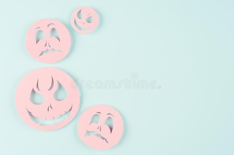 Halloween concept art of cut paper - pink soar funny monster faces on candy mint background, copy space. Halloween concept art of cut paper - pink soar funny stock image