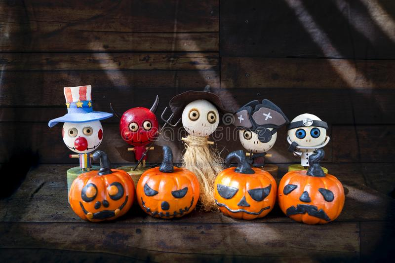 Wooden happy ghost gang with halloween pumpkin. Halloween concept background, wooden happy ghost gang with halloween pumpkin, ghost collections, Hallowen royalty free stock photos