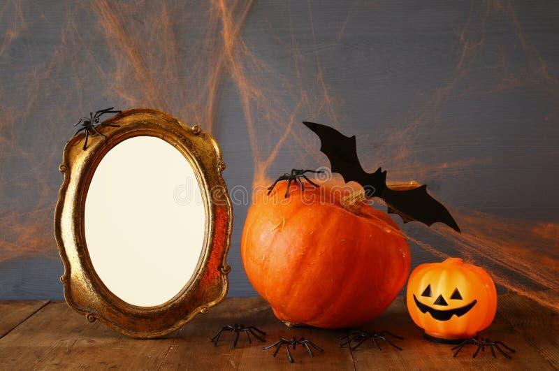 Halloween concept. Cute pumpkin next to blank photo frame stock image