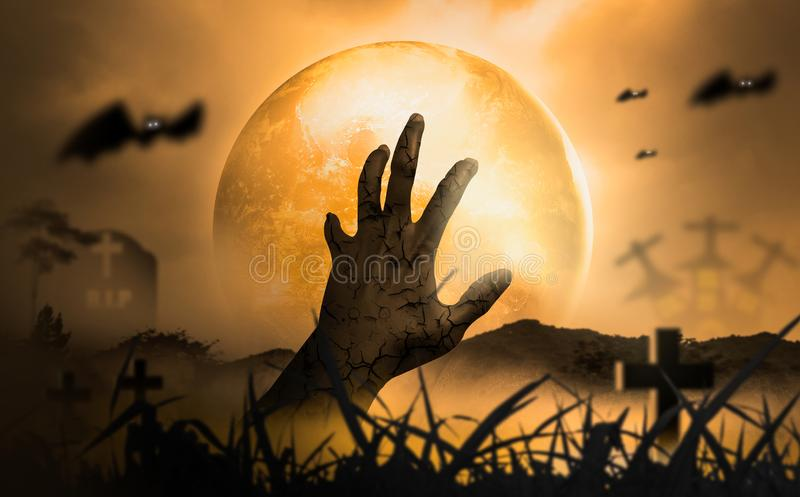 Halloween Concept Horror, night with resurrected zombie hands popping out of hell With moon floating in sky, atmosphere in cold. Cemetery and grave is full of royalty free stock images