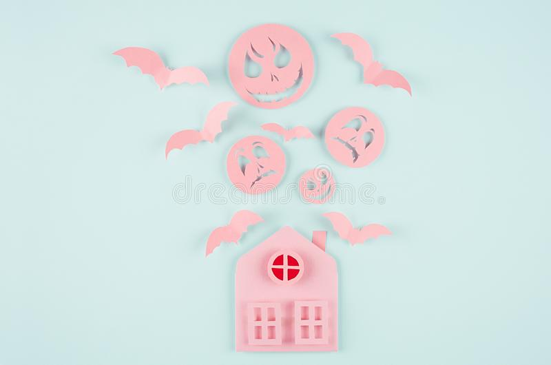 Halloween concept origami cartoon art - pink terrible house with bats fly, red window and spooky faces on trendy pastel mint blue. vector illustration