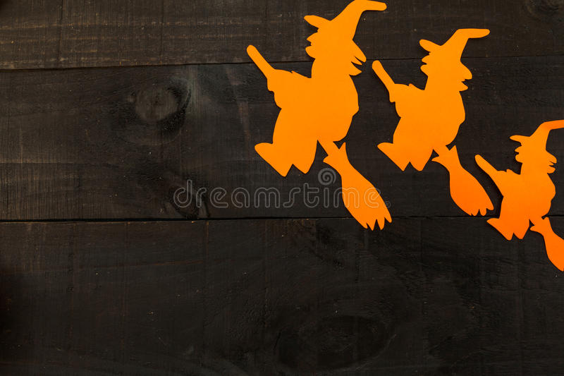 Halloween concept. Picture taken from above with halloween elements framing a possible text on wooden background and the colors of red and orange royalty free stock images