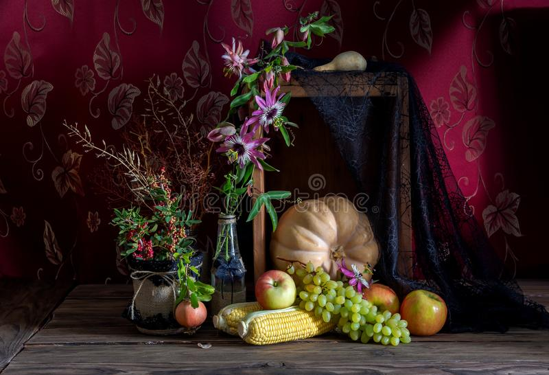Still Life with pumpkin on wooden background. stock photography