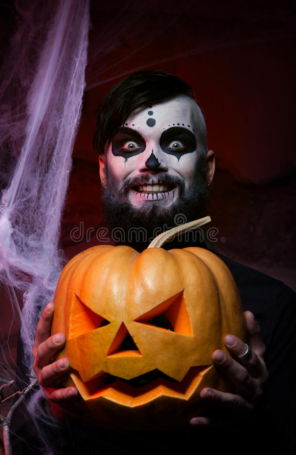 Halloween concept with young man. In day of the dead mask face art royalty free stock photos