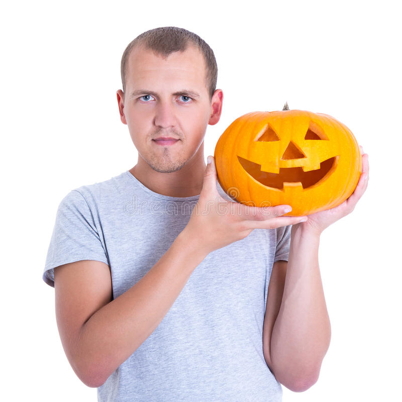 Halloween concept - young man with pumpkin Jack-O-Lantern isolat royalty free stock photography