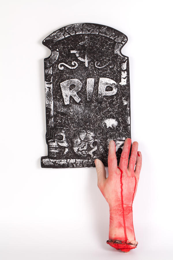 Halloween concept, zombie hand rising out from the ground isolat royalty free stock photography