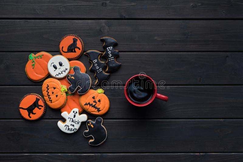 Halloween cookies and cup of coffee royalty free stock images