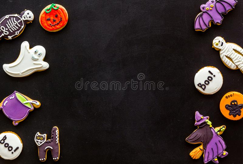 Halloween cookies in shape of spooky figures frame on black background top view mock up. Halloween cookies in shape of spooky mystic figures and characters frame stock image