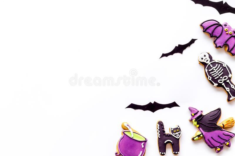 Halloween cookies in shape of spooky figures frame on white background top view copyspace. Halloween cookies in shape of spooky mystic figures and characters royalty free stock photo