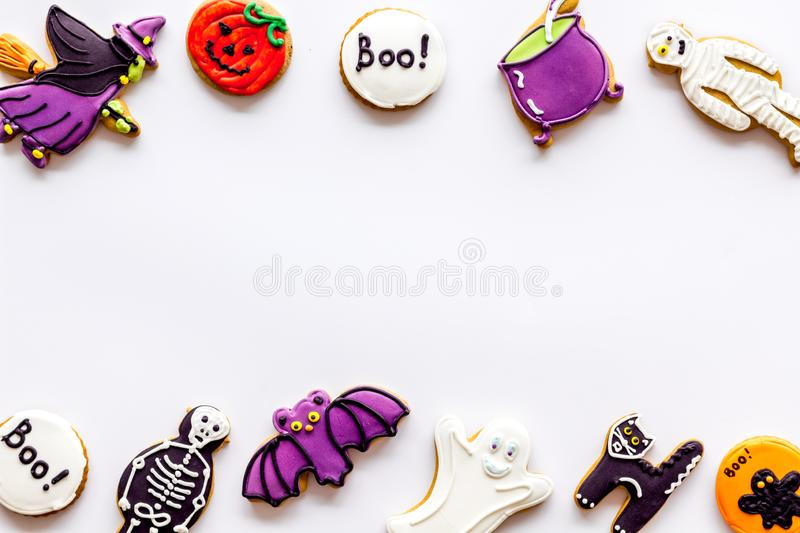Halloween cookies in shape of spooky figures frame on white background top view mock up. Halloween cookies in shape of spooky mystic figures and characters frame royalty free stock images