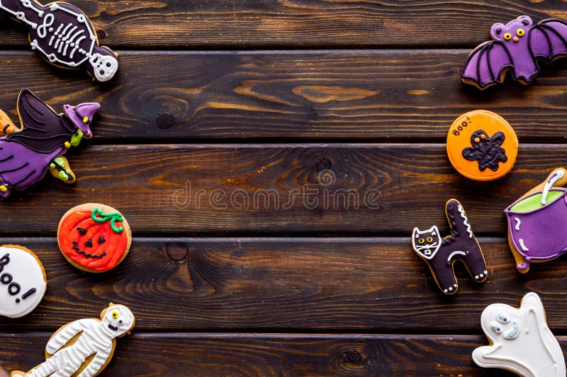 Halloween cookies in shape of spooky figures frame on wooden background top view mock up. Halloween cookies in shape of spooky mystic figures and characters stock photography