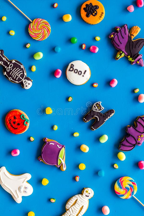 Halloween cookies in shape of spooky figures pattern on blue background top view. Halloween cookies in shape of spooky mystic figures and characters pattern on royalty free stock photos