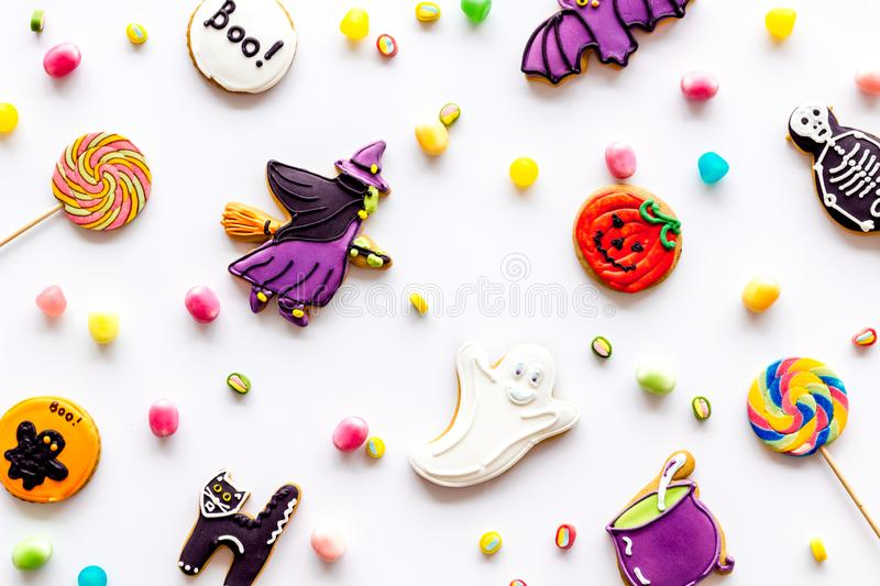 Halloween cookies in shape of spooky figures pattern on white background top view. Halloween cookies in shape of spooky mystic figures and characters pattern on stock images