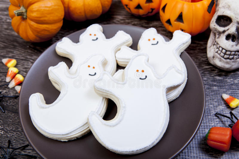 Halloween cookies. Halloween themed cookies and candy corn royalty free stock photo