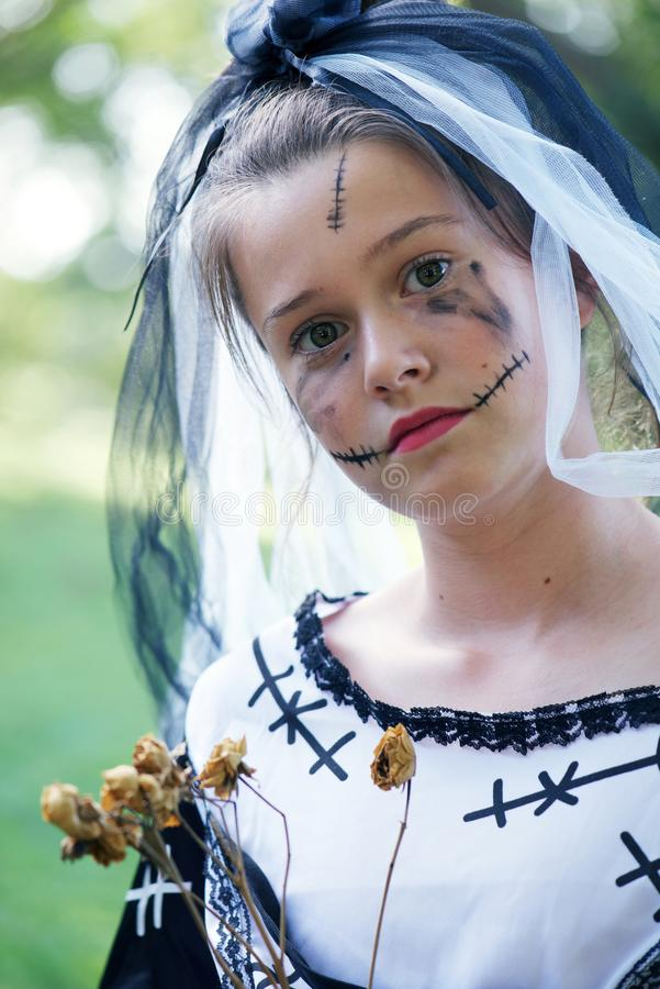 Halloween Corpse bride. Young girl wearing a halloween costume featuring the corpse bride and face painting scars stock image