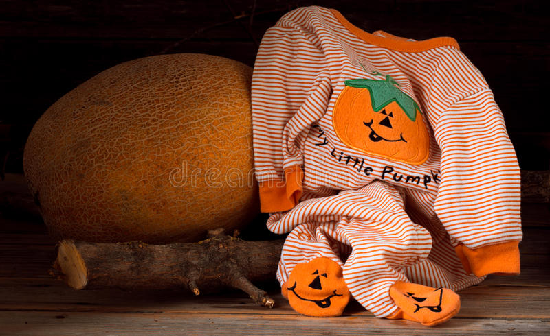 Halloween costume for a child, on wooden background.  royalty free stock photography