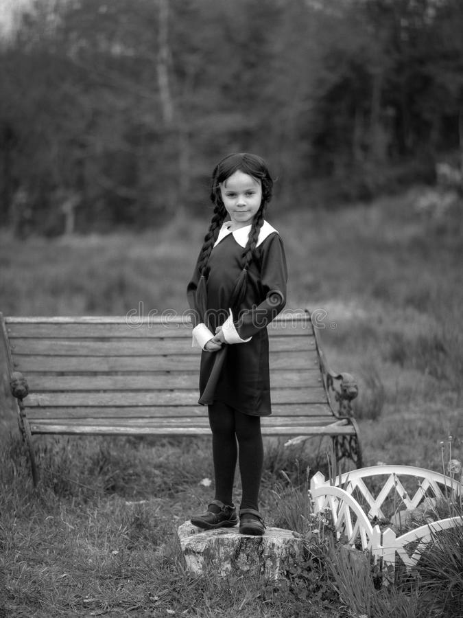 Halloween Costume. A little girl dressed up as Wednseday Addams royalty free stock image