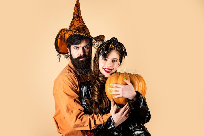 Halloween couple embracing. Best friends celebrated Halloween. Trick or treat. Retro Halloween couple romancing. royalty free stock photography