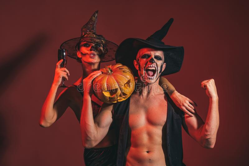 Halloween couple with makeup on shouting face hold pumpkin royalty free stock images