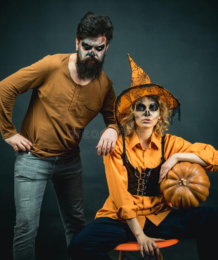Halloween couple with pumpkin celebrating happy Halloween. Two friends at a Halloween party. stock image