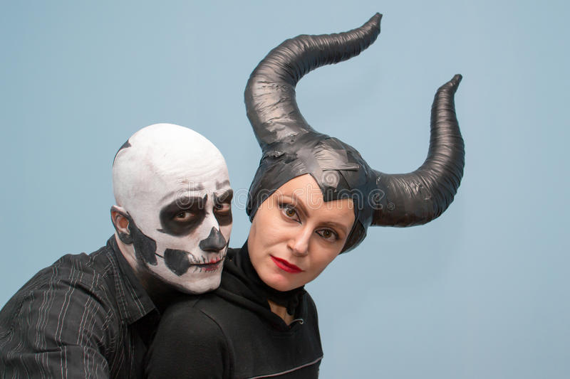 Halloween couple in traditional costumes and makeup royalty free stock photos