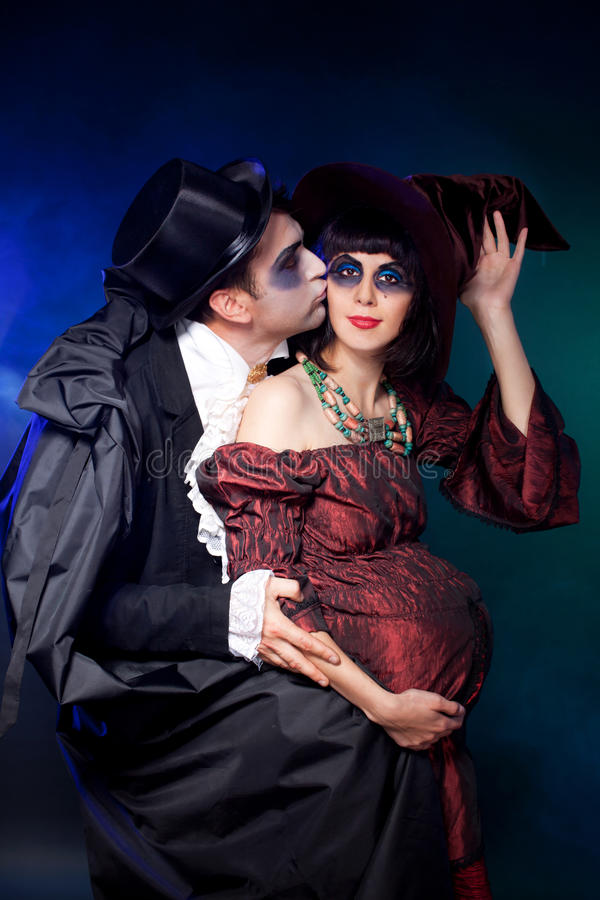 Halloween couple wearing vampire and Witch royalty free stock image