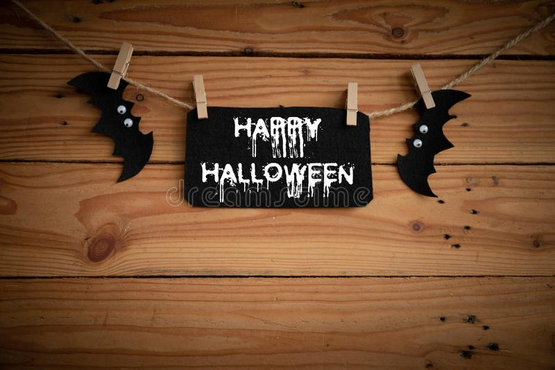 Halloween crafts, bat, spider and cobweb on wooden table background with Happy Halloween text. halloween concept. and cobweb on w royalty free stock images