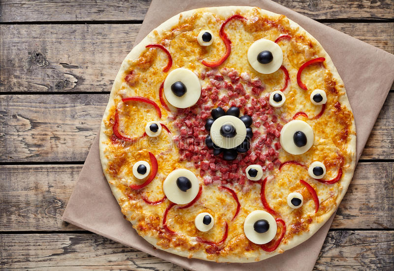 Halloween Creative Scary Food Monster Pizza Snack With Eyes On Vintage Wooden Table Background Traditional Homemade Celebration Party Decoration