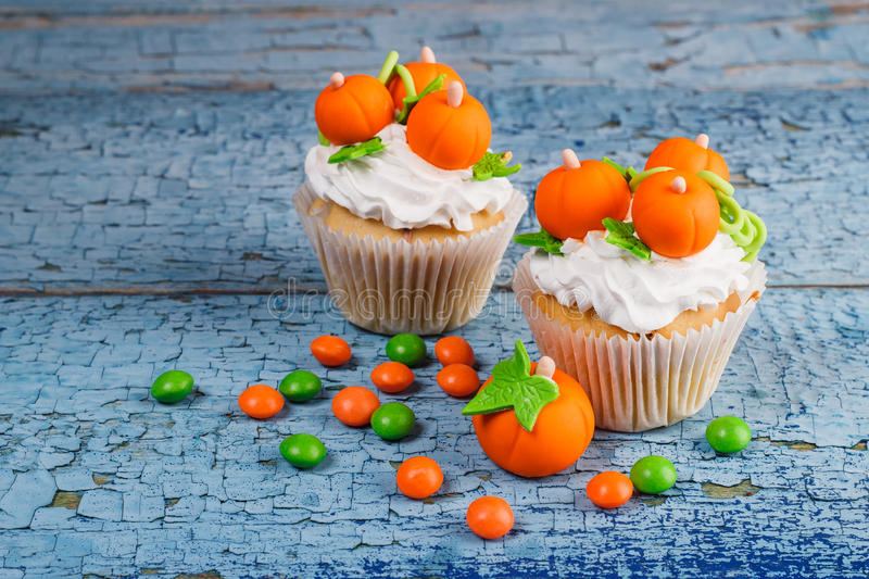 Halloween cupcake with colored decorations stock photography
