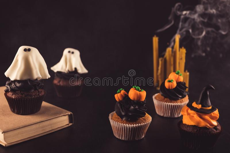 Halloween cupcakes and candles royalty free stock images