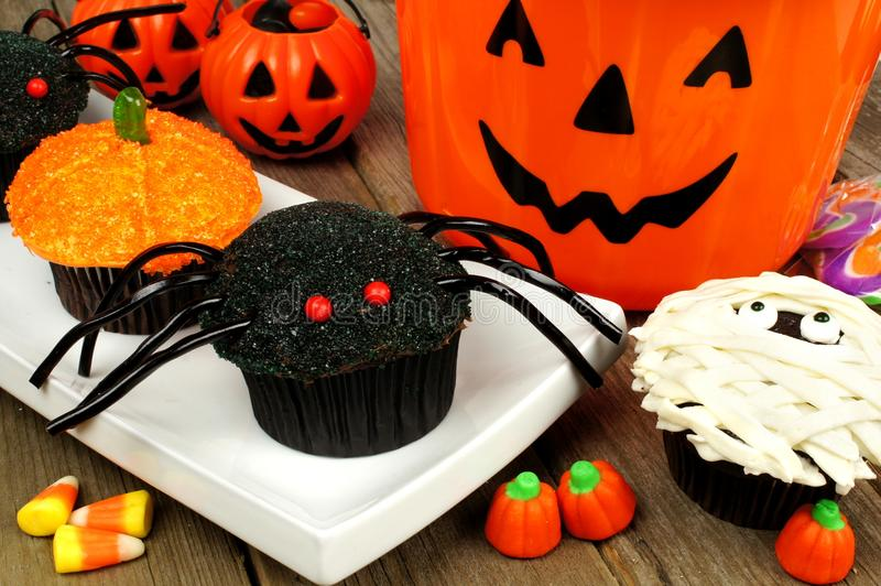Halloween cupcakes with candy and decor stock photos