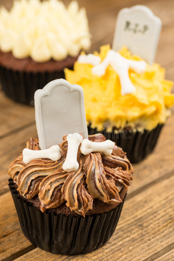 Halloween cupcakes on an old rustic wooden table stock photography