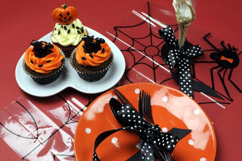 Halloween cupcakes with orange pla