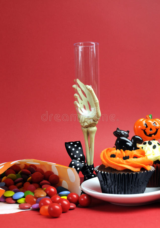 Download Halloween Cupcakes, Skeleton Glass And Candy Treats On Red Background - Vertical. Stock Photo - Image: 30399664