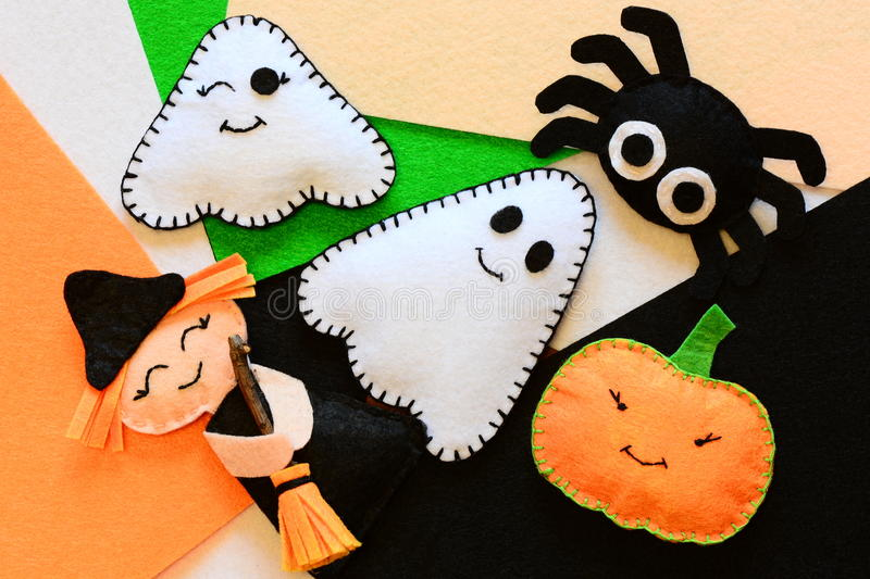 Halloween cute felt ornament decor. Small witch with broom, pumpkin head, two ghosts, spider. Halloween toys crafts royalty free stock images