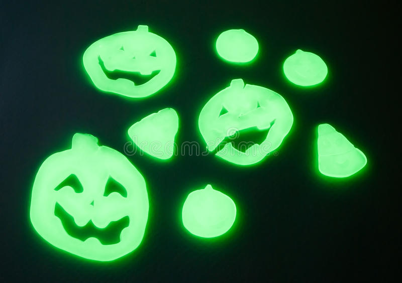 Halloween in the dark. Halloween gel charms in the dark, pumpkins and ghosts royalty free stock photos