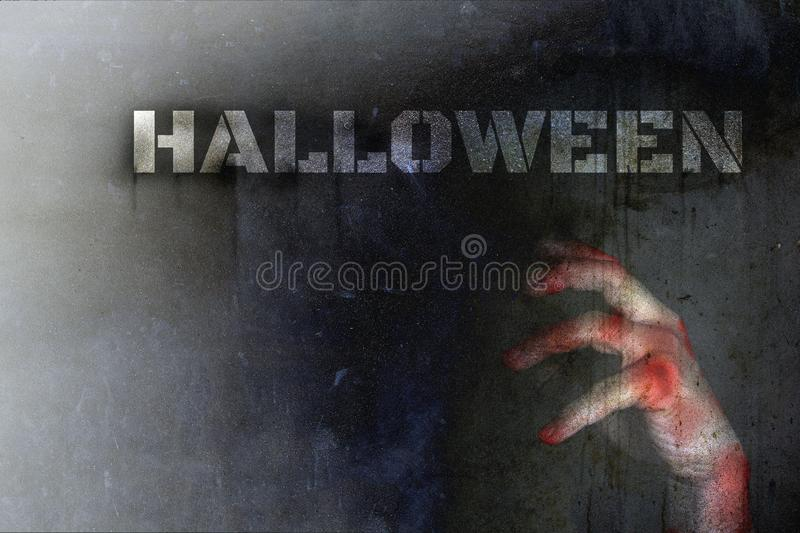 Halloween day concept, Double Exposure, Hand bruise bloody of zombie horror in a darkness on a dirty wall background with copy sp stock photography